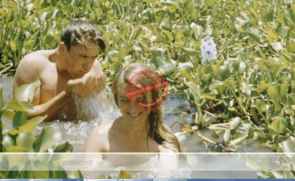 Lothar and Ann Wuerslin taking a bath in Lake Chapala wster hyacinths, 1957. Photo by Leonard McCombe, Life