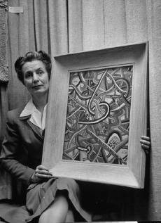 "Woman holding Naromji's ""Three out of Five"". (Life archive)"